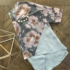 Floral high-low crop top Worn twice, no flaws.  Beautiful color palette with dusty gray blue sheer details.  Longer in the back, great with shorts or white skinny jeans! Brand is Love Fire from Nordstrom Tops Crop Tops