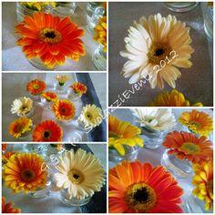 An idea! with colours flowers! http://svolazzieventi.blogspot.it/2012/07/un-centrotavola-fiorito-e-colorato.html