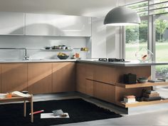 FITTED KITCHEN SYSTEM BY SALVARANI | DESIGN CASTIGLIA ASSOCIATIblanco combinaco con madera