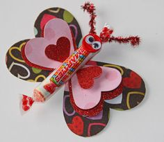 Valentine Card Craft.  If you're kids are pretty crafty, or you want to get more involved, try this adorable butterfly card made out of Smarties and paper.