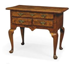 A GEORGE I WALNUT, LINE-INLAID AND CROSSBANDED LOWBOY   EARLY 18TH CENTURY   With later handles, restorations   28 in. (71 cm.) high; 34 in. (86 cm.) wide; 20 in. (51 cm.) deep