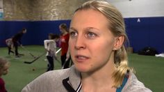 Olympian Kendall Coyne teaches hockey to young girls at the Game On! Power4Girls clinic.