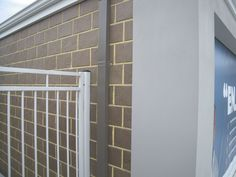 Interesting colour with the double course bricks, light mortar and grey render