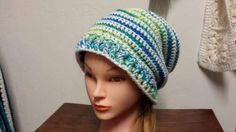 Check out this item in my Etsy shop https://www.etsy.com/listing/502253946/a-ponytail-hat-slouchy-hat-and-headband