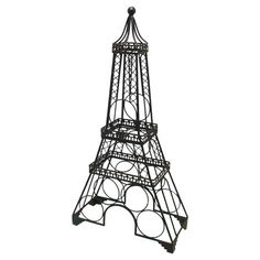 Metal Eiffel Tower wine rack.   Product: Wine rackConstruction Material: MetalColor: Charcoal...