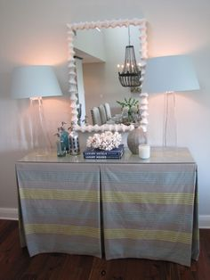 Hide an ugly table with a box-pleated slip cover.  Endless fabric possibilities