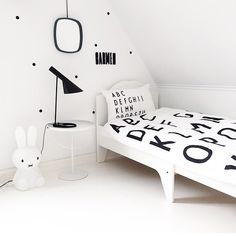 Polka dots and alphabet. So simple and lovely. Black and white done well // kids space