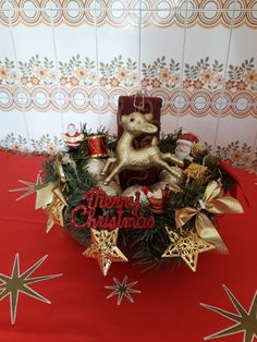 DIY Christmas red and gold centrepiece with gold stars battery lights, red candle and gold reindeer