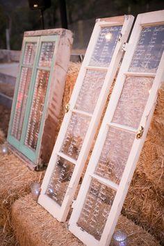 David Tutera rustic wedding window seating chart on hay bale barrels