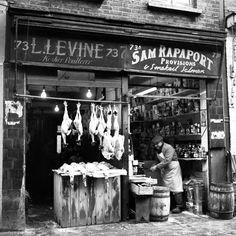 East London, c 1955. What a photo! Shopkeepers hard at work and showing off their goods in the East End of London in this photo we found on museumoflondonprints.com. #London #historicLondon