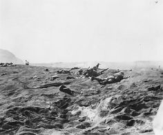 A reserve wave of the 4th Marine Division waiting on the beach, Iwo Jima