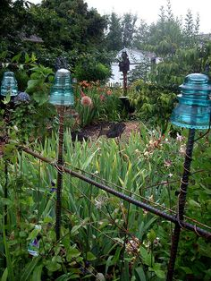antique electrical insulators as garden art by lehua_mc, via Flickr