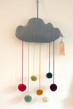 DIY inspiration: pompom cloud - would be so cute for a nursery