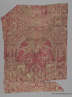 Textile fragment from the shrine of San Librada, Sigüenza Cathedral    Location:  New York, United States of America    Holding Museum:  The Metropolitan Museum of Art        Date of Object:  Hegira late 5th–first half 6th century / AD first half 12th century    Period / Dynasty Taifa kingdoms  Provenance: Spain