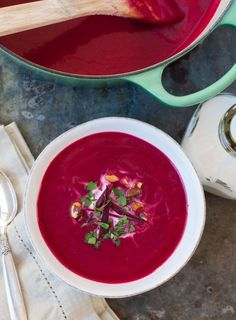 Beet, ginger and coconut soup! This is a simple, healthy, beautiful and vegan winter weeknight soup. This soup tastes like beets, but the ginger, coconut oil and coconut milk help to soften the earthy flavor of the beets and gives them a subtle sweetness. The pureed texture of the soup is creamy, light and soft!