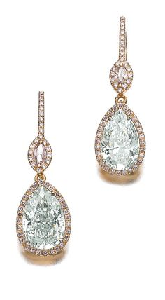 These fancy blush & white diamond and diamond earrings weigh 1.99 carats and 2.42 carats each and surmounted with a marquise-shaped diamond of blush tint, framed with brilliant-cut diamonds of similar color. Via Sotheby's.