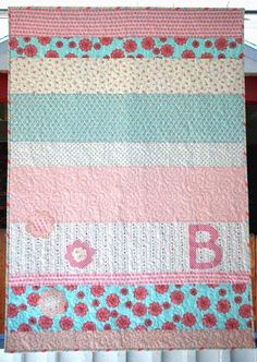 """Beatrix Quilt Pattern via @Craftsy Striped quilt SIZING / FINISHED MEASUREMENTS: 38"""" X 56"""" MATERIALS: 1/3 of a yard of 2 fabrics 1/4 of a yard of 6 different fabrics 1 3/4 of a yard for backing fabric 1 1/4 of a yard for bias binding Scraps or fat quarters for optional applique"""