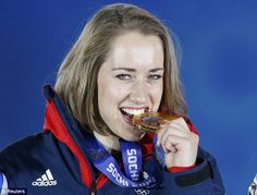 Golden girl: Lizzy Yarnold celebrates her win as she is presented with her medal at Sochi...