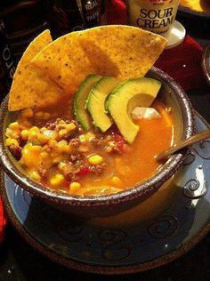 Taco Soup!!   Servings: 9 • Size: 1-1/4 c • Old Points: 3 pts • Points+: 5 pts  Calories: 198.8 • Fat: 1.4 g • Carb: 29.7 g • Fiber: 7.0 g • Protein: 19.5 g    1.3 lbs 99% lean ground turkey  1 med onion, chopped  1 bell pepper, chopped  10 oz can rotel tomatoes with green chilies  15 oz canned or frozen corn, drained  15 oz kidney beans, drained  8 oz tomato sauce  16 oz fat free refried beans  1 pack taco seasoning   2 1/2 c. fat free low sodium chicken broth