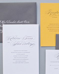 A purple-and-white palette set the tone for something traditional on these Atheneum Creative invitations. A yellow response card added an unexpected pop of color.