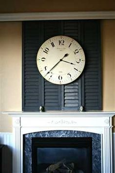 """DIY:: Sliding Shutter -Shutters made into a sliding """"barn"""" door to hide the TV when not in use. Great Idea & Tutorial !"""