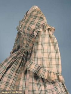 Woven plaid, American, c.1860s. High bodice with inset waistband, shell buttons and functional buttonholes, open sleeves with flounce at amscye and finished with flounce at bottom. Skirt gauged or gathered. AUGUSTA AUCTIONS