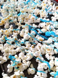Ready to Pop themed bridal shower favors: blue drizzled popcorn