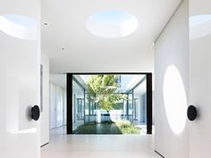 White interior, ceiling walls & floor black accents, green plants, light blue from skylights & open interior courtyard sky Art Photography /Canvas Paintings should be considered in limited amount Grand Designs Australia - Series Brighton Sixties