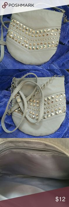 Grey Silver Studded Purse Crossbody Shoulder Bag Adorable purse, cross body, hangs at the hip. Can easily fit your phone wallet and makeup. Lightly used with no signs of wear. 7 1/2 tall 7 1/2 wide. Bags Crossbody Bags