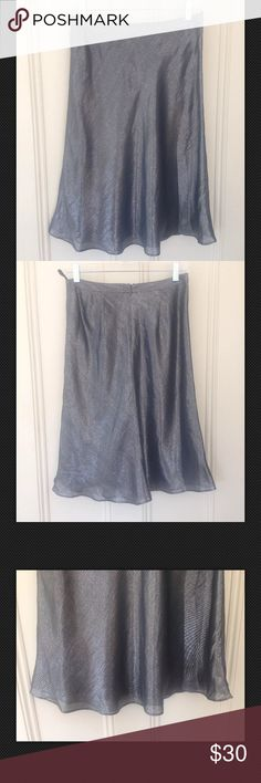 Banana Republic Silk Metallic Gray Skirt A-Line Gorgeous Banana Republic Dark Gray Metallic Skirt Mid-Calf A-Line Shimmering Sexy Evening Sz 2. Flowing and flirty. Great for evening events. Lined – dark gray.   Wrist: 14.5 inc Length: 26.8 inc Banana Republic Skirts A-Line or Full
