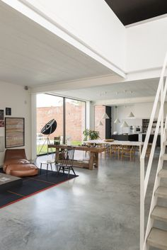 Concrete floors, white walls, wood browns furniture