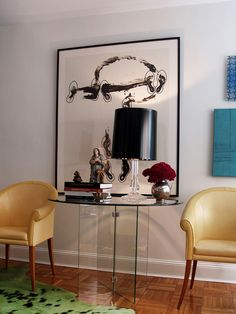 The client's collection of modern furnishings, artwork and world crafts is very eclectic. The Donghia butter leather chairs, Latin American colorful cow skin rug and artwork and antiques from around the world add interest