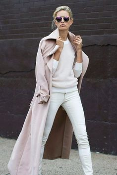 pale pink coat draped over shoulders of all white outfit + cool dark shades