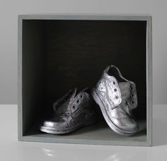 If there are small children in your family this is a must-have gift! Take baby's first shoes, spray paint them and mount. We used Plastikote FDE in Chrome.