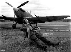 World War Two, RAF Base (Somewhere in England?, A pilot in full uniform ready to respond to orders takes a moment to relax in a wicker chair placed near his spitfire Ww2 Aircraft, Fighter Aircraft, Military Aircraft, Fighter Pilot, Fighter Jets, Raf Bases, The Spitfires, Supermarine Spitfire, Battle Of Britain