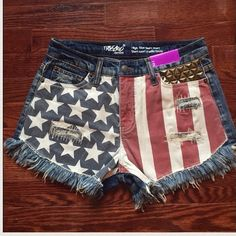 Highwaisted, studded, American flag Jean shorts Brand new, custom, high waisted jean shorts. Size 2/26. American flag pattern, distressed jeans. Front and back pocket studded with vintage gold studs. Shorts Jean Shorts