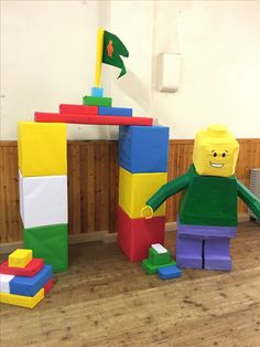 Giant Cardboard Lego Man!  I created this with cardboard, paper mache, a few recycled items from around the house, coloured paper and paint!  It was very popular at my Son's Lego Party!