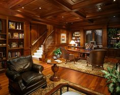 Wood Paneling Adds Elegance And Warmth To Your Home Office. And the rugs add comfort and style.
