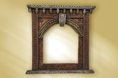 Traditional Rajasthani style wooden window frame, with authentic carving.