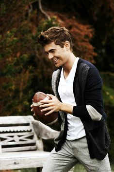 Zac Efron. With a football. Omg.