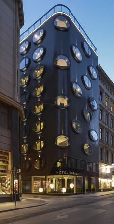 Hotel TOPAZZ - Vienna / REMINISCENT OF A SCULTPURAL CREATION BY KOLOMAN MOSER – A SPARKLING CYLINDER, STUDDED WITH LARGE, OVAL PRECIOUS STONES