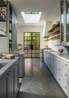 Love the variety of open shelves, glass doors and different colored cabinets and different counters.