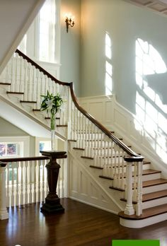 "Restored staircase in Georgian Colonial home in Toronto. Mahogany rail. Quarter sawn oak floors stained in a mix of sedona and walnut by Minwax. Balusters are 1 3/4""."