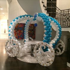 Winter Wonderland themed party decoraionwith princess carage balloon sculpture