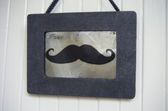 Mustache antiqued mirror in black frame by BusterJustis