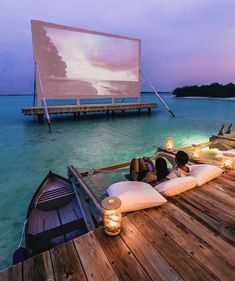 Watching a movie  The biggest over water cinema in Maldives @missangievilla #couple
