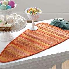 A carrot table runner is perfect for an Easter table. Strips of orange are an easy way to use up scraps.