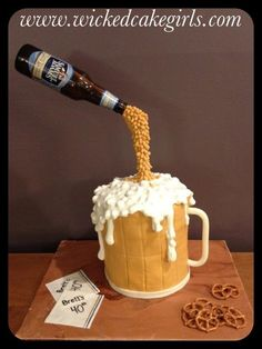 Pouring beer gravity defying cake.