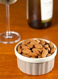 The 10 Healthiest Food Pairings: Red Wine + Almonds to keep your heart happy.