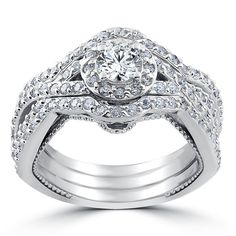 Product Details Item # ENG0627.5 Width: 2 mm Metal: 10k White Gold Diamond Quantity: 99 Diamond Setting: Prong   1 1/2ct Halo Engagement Trio Infinity Vintage Ring Set 10k White Gold  Womens ring set features a 1/2ct center and 98 round cut diamonds. All diamonds are set in solid 14k white gold. Ring set includes all three rings.